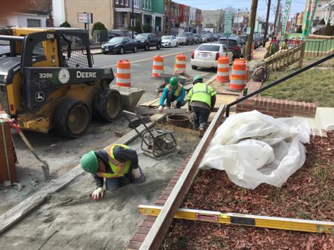 Contractor adjusting manholes at station 31+75LT