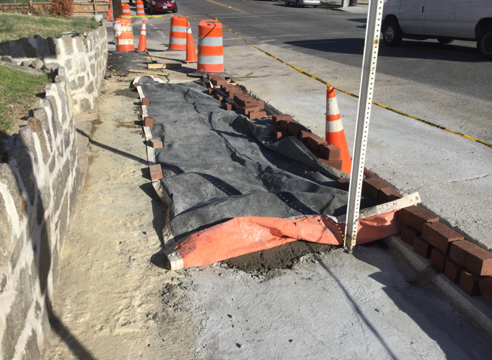 Paving placed blanket over PCC base for brick sidewalk soon after finishing from Sta. 40+45LT to Sta. 40+66LT.