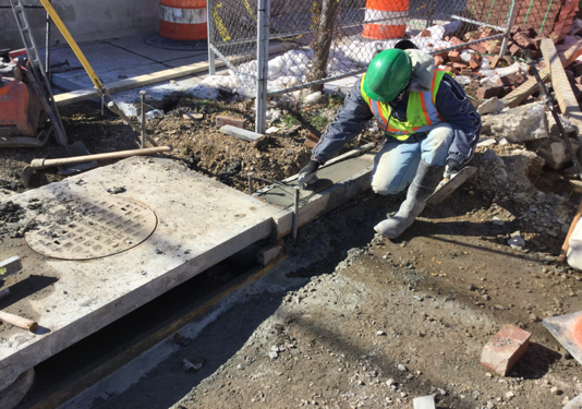 Contractor finishing PCC curb from Sta. 141+94Lt to Sta. 141+97LT.
