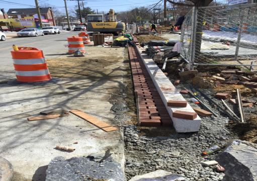 Brick gutter installation from Sta.61+90RT to Sta.62+41RT