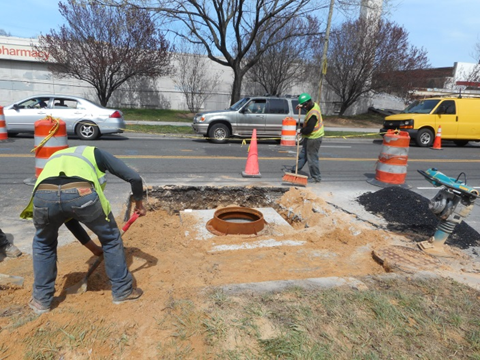 Capitol Paving installing and backfilling street light manhole #14 on the south side of Missouri Avenue