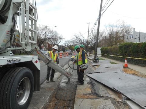 Pouring PCC Base in the electrical conduit trench between M14 and M3 on Missouri Avenue