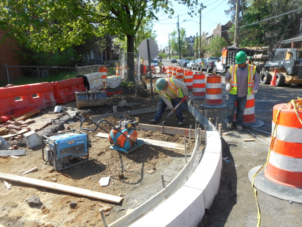 Preparing the concrete form for the proposed wheelchair ramp at 1st street NW