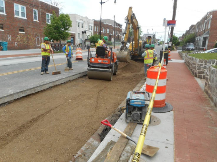 Capital Paving compacting GAB at N/W corner of 4th Street
