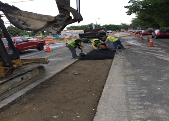 Asphalt placed from sta. 509+25 to sta. 511+02 in the excavated median.