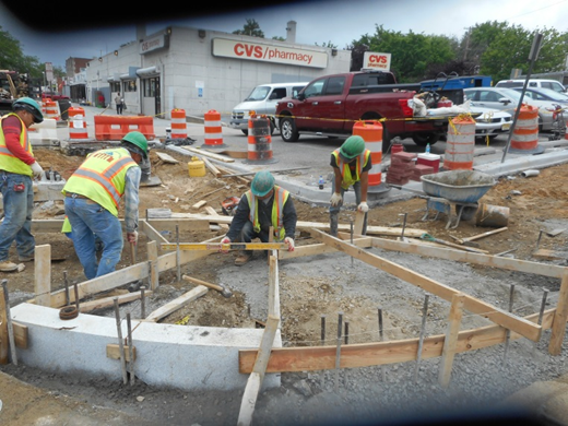 Forming ADA ramps at the south-east corner of 2nd St & Kennedy St