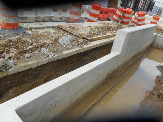 Capital Paving base concrete undermining from rain Seat Wall BR C-4