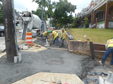 Capitol Paving pouring PCC sidewalk at the S/W of 2nd & Missouri Ave. NW