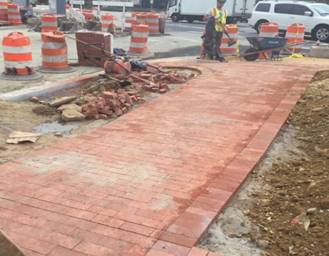 Completing Brick Sidewalk Installation Triangle at Kennedy ST and Missouri Ave Sta.121+50LT To Sta.122+00
