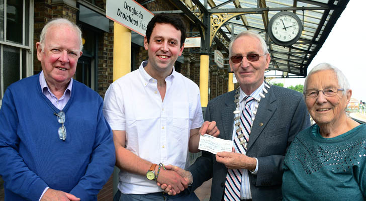 Donal O' Meara, President of Malahide Lions Club pictured with Austin Campbell and Ide Lenihan of Drogheda Civic Trust after handing over cheque for €1,000