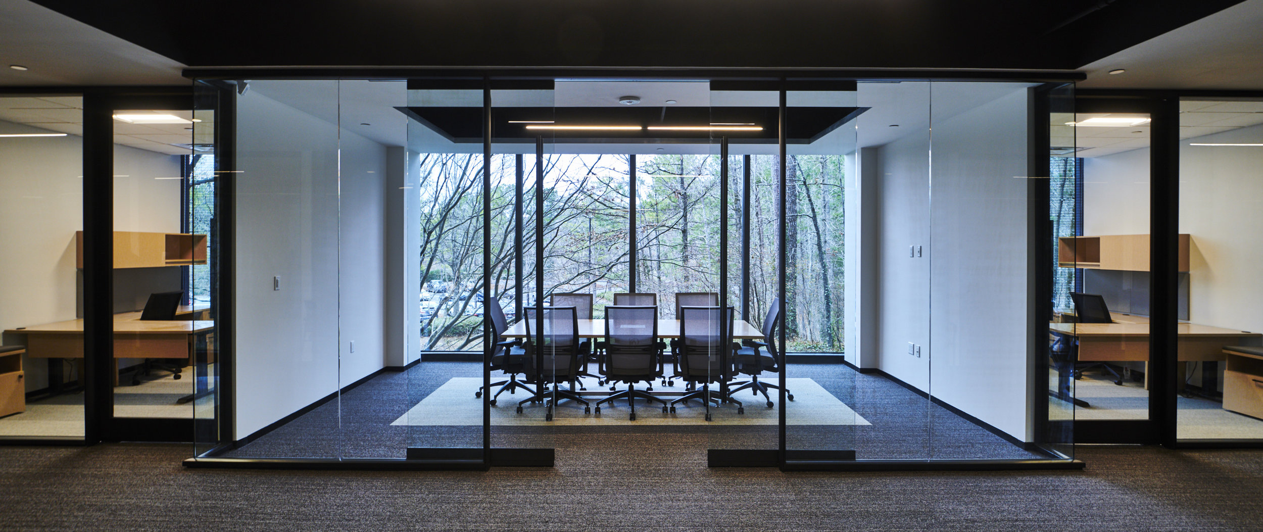 Strong axial views through the building of the surrounding forest are found throughout the space providing a connection to the what drives the company.