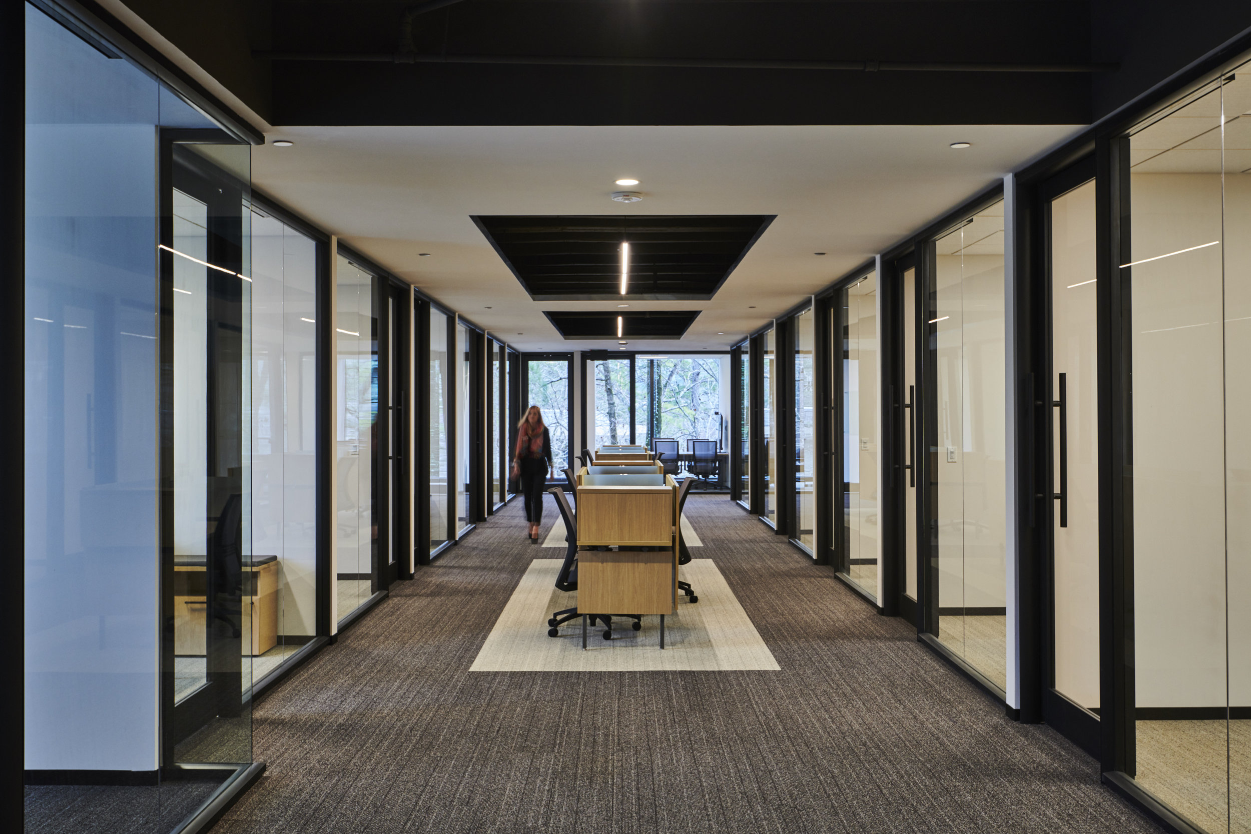 Private offices with glass along the interior corridors allow natural light and views for everyone.