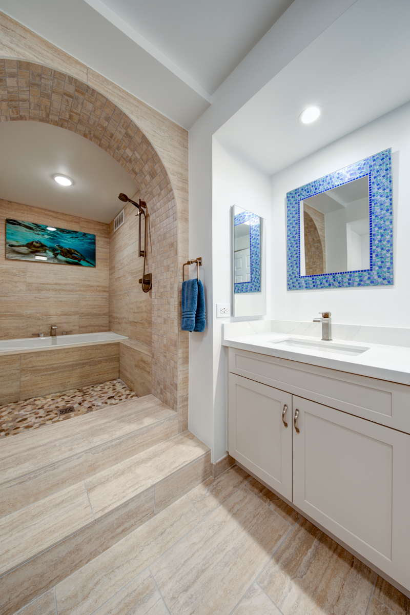 We went with large 2 feet by 4 feet tile for the walls and floors. The large tile bring a elegance to a bathroom, that you won't get with smaller tiles. The fact that these bathrooms are large for an apartment allowed us to do use these larger tiles. You don't want to do large tile in a tiny bathroom. It just wouldn't look right.