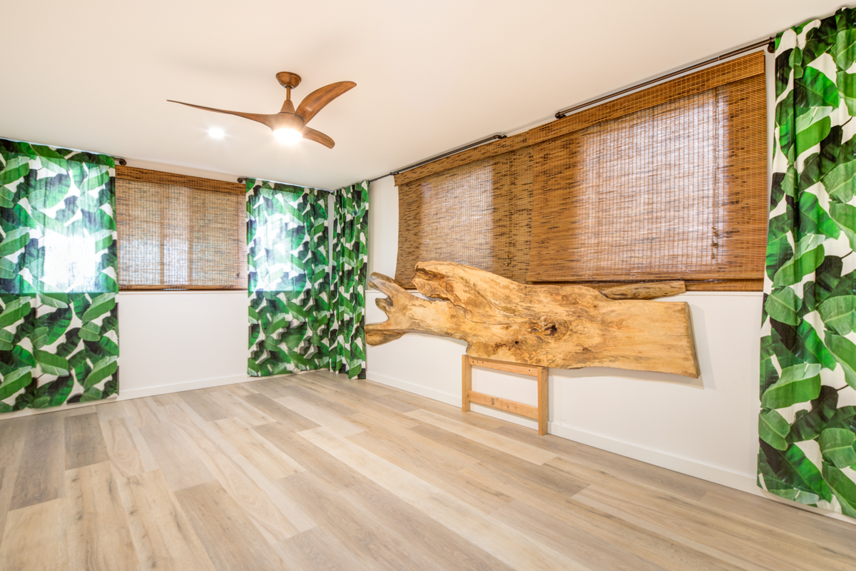 We created a totally one of a kind Mango Slab Head Board for this beach feel bedroom. We got this slab from Kalama Hardwoods.