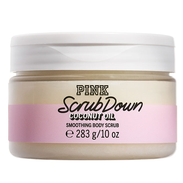 PINK  SCRUB DOWN  Smoothing Body Scrub   On back:  Buff away dry skin in flash. Coconut Oil and Sugar Crystals gently polish and smooth. Hello, healthy glow.   Trending and Trusted:  We've infused super-luxe, skin-loving Coconut Oil, one of nature's most powerful ingredients into our must-have Bodycare. The secret to Coconut's legendary status? Fatty Acids— weird name but mega softening—for glowing, healthy-looking skin