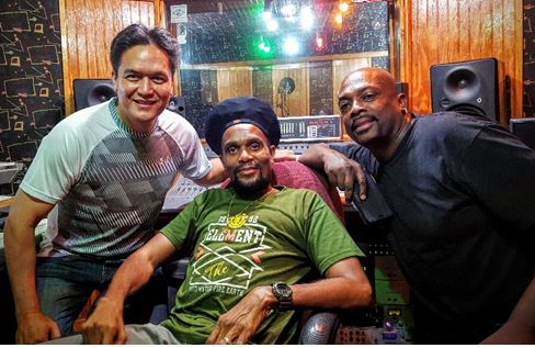 "Left to Right: Mark Loquan, Junior ""Ibo"" Joseph, Anslem Douglas in the studio"