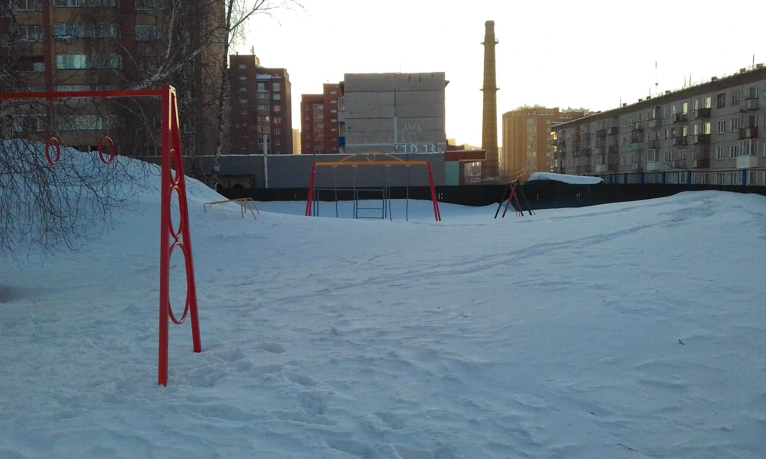 Winter might be reaching its technical end, but snow mountains still abound. And when it does finally thaw, we'll have one soggy city. (That's a full playground under the snow, by the way.)