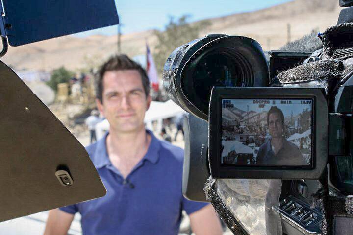 Jonathan Samuels filming on assignment in Chile