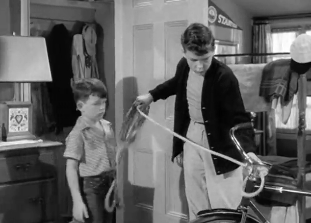 The original Wally ties up the bike with the rope they happen to have at the ready