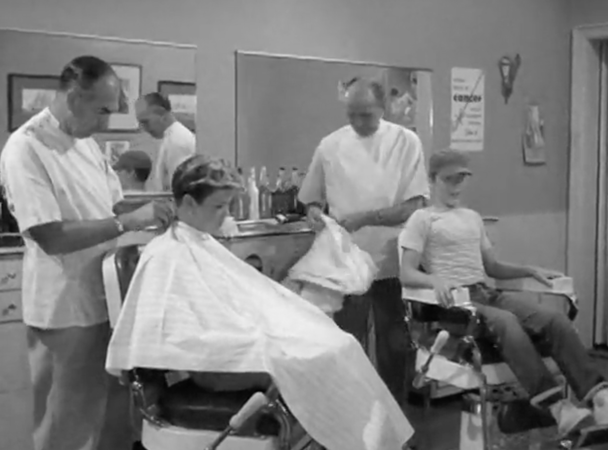 Chester Anderson not only has an extra ticket to the football game, he also is getting the haircut that Wally only wishes he could get!