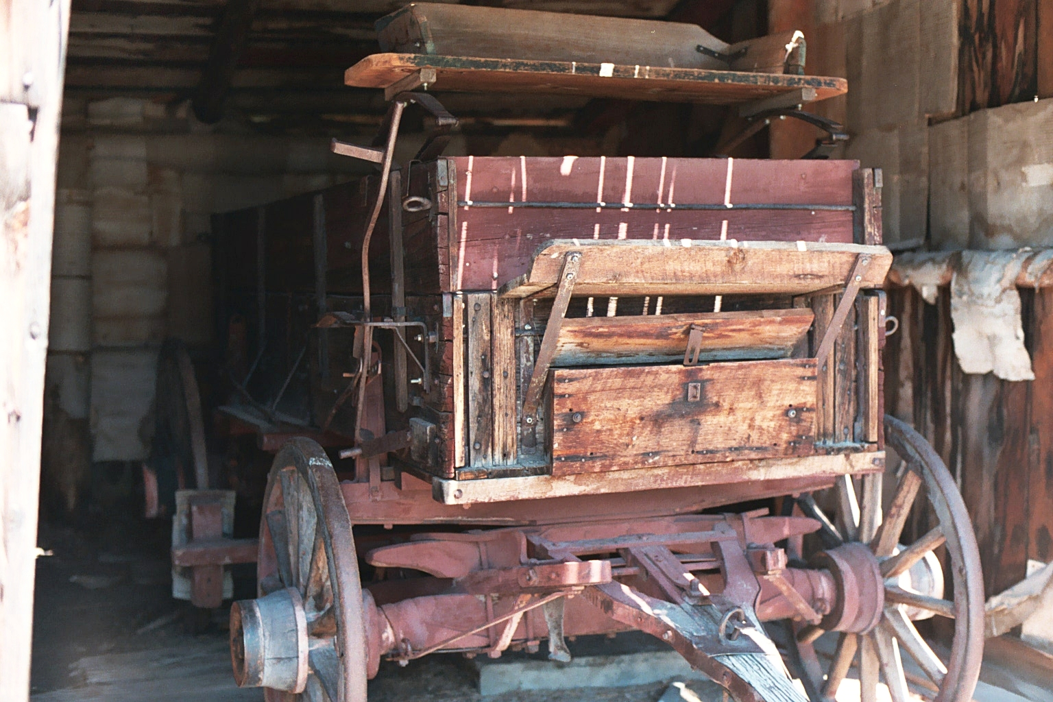 Buckboard Wagon in shed.JPG