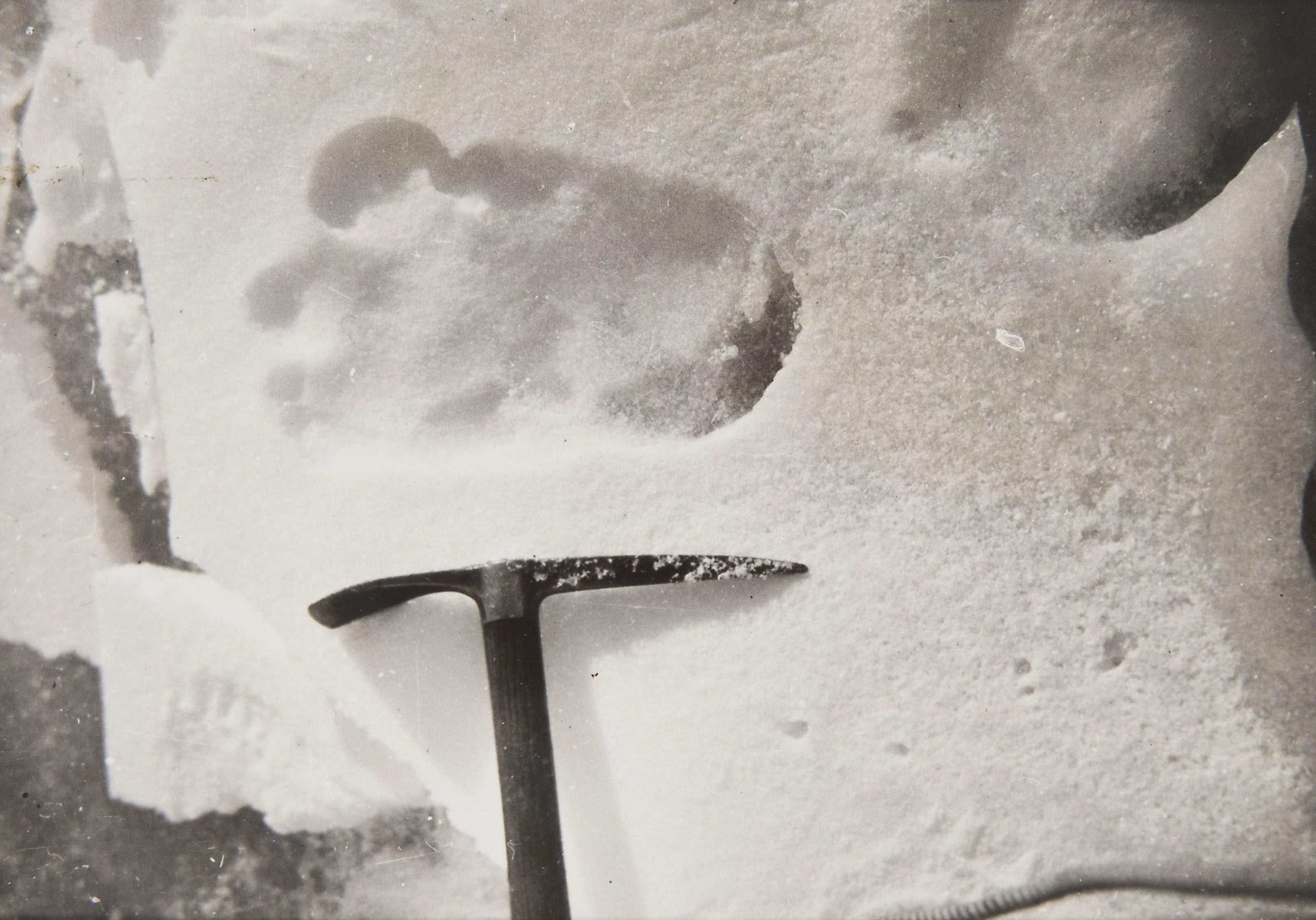 "The original framing of Shipton's famous ""Yeti footprint"" photo."