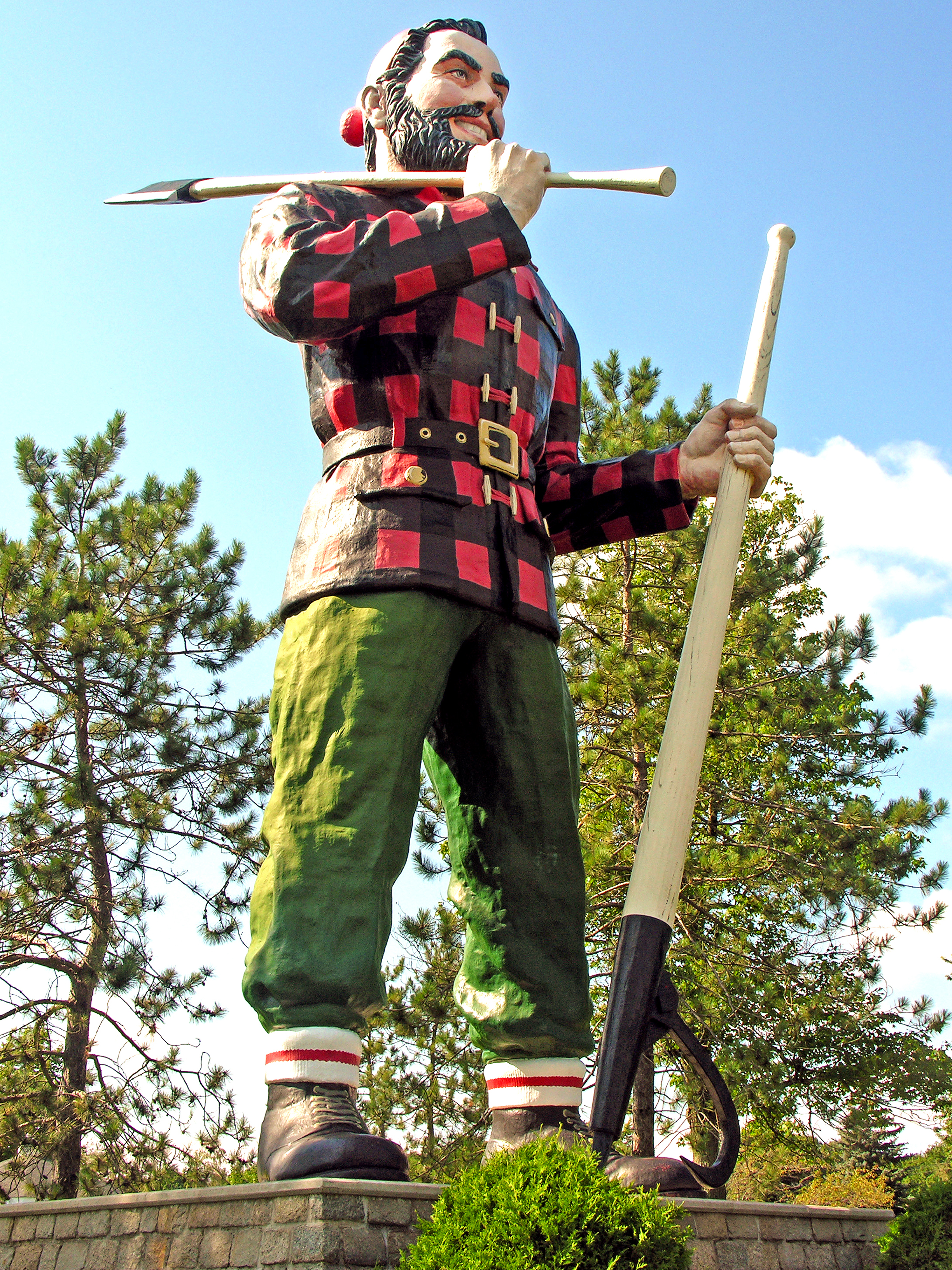 "From  RoadsideAmerica.com : Bangor's Paul Bunyan, ""Reputed to be the largest statue of Paul Bunyan in the world,"" according to its sign, stands on a stone pedestal in front of the Bangor Civic Center in Bass Park. The statue is 31 feet high and weighs 3,700 pounds, not including its double-sided ax and peavey. Paul Bunyan's fiberglass-over-metal frame is hurricane-proofed to withstand 110 mph winds.  Photo by Dennis Jarvis [CC BY-SA 2.0 via Wikimedia Commons"