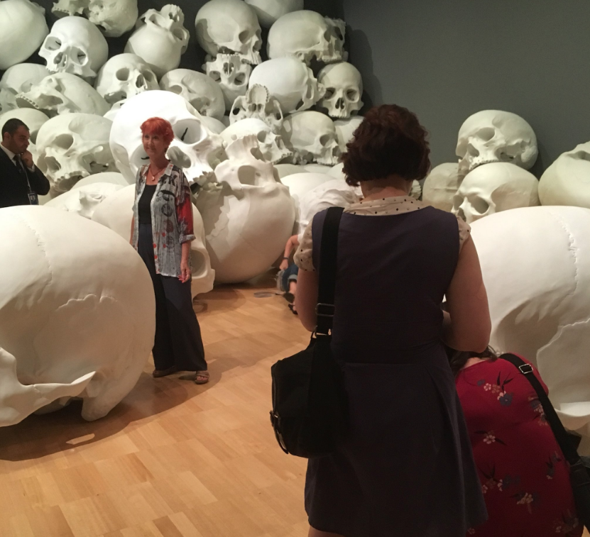 "Picture provided by listener ""JoMo"" (@leopardboy on Twitter) of Sculptor Ron Mueck's  installation featuring giant skulls , on display at the Australian  National Gallery of Victoria Triennial  museum."