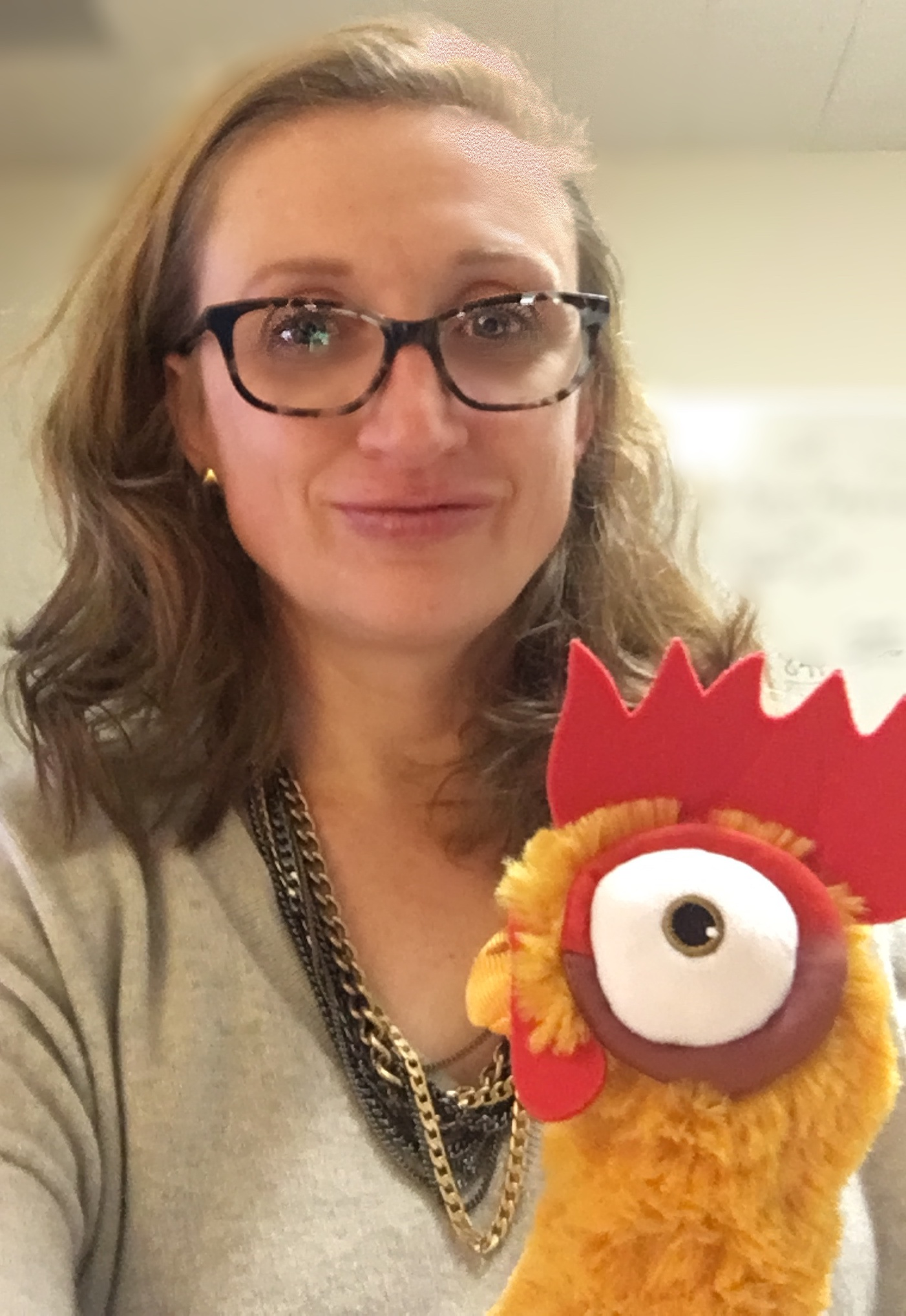 "Marie Mayhew, wife, mother, CIA operator under deep hypnotic cover, and co-host of  The Mad Scientist Podcast  along with Dr. Cogswell.  Pictured here with her stuffed Rooster ""Heihei"" who... um... I guess she says, ""speaks to me."""