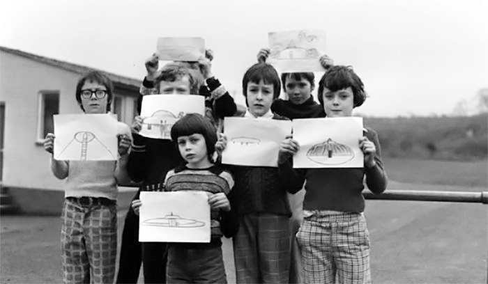 Students from the  Broad Haven Primary School  in Broad Haven, Pembrokeshire, Wales, showing their drawings of the craft they spotted on the playground.