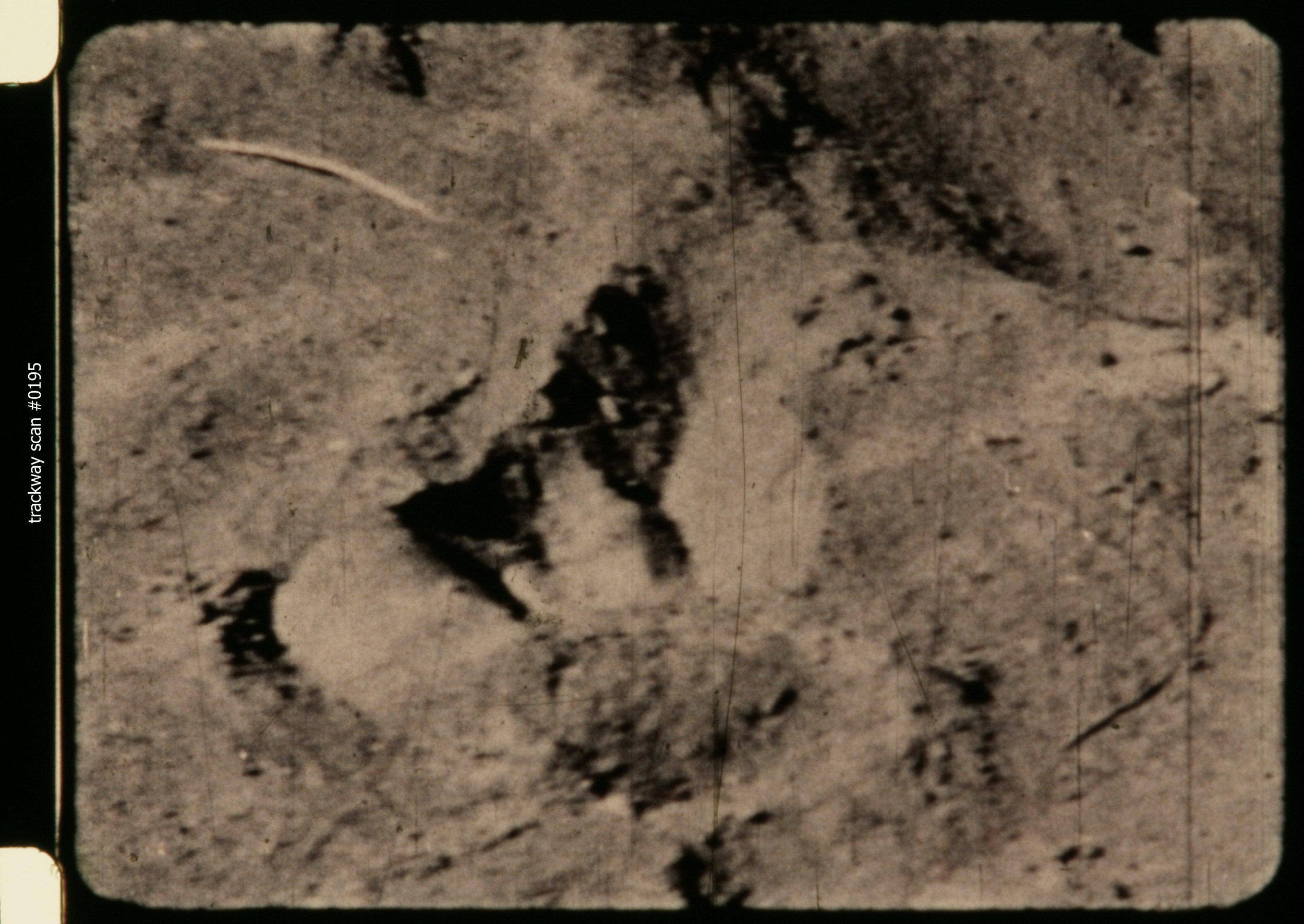 "Scan #0195 by Bill Munns  of trackway footage from John Green's archives.  ""This was the first time this footprint footage was ever scanned at 4K resolution, every frame known to exist.  The four reference images … are among the sharpest frames for each footprint.  The footage was scanned end to front, which is why scan numbers are highest first, lowest last."""