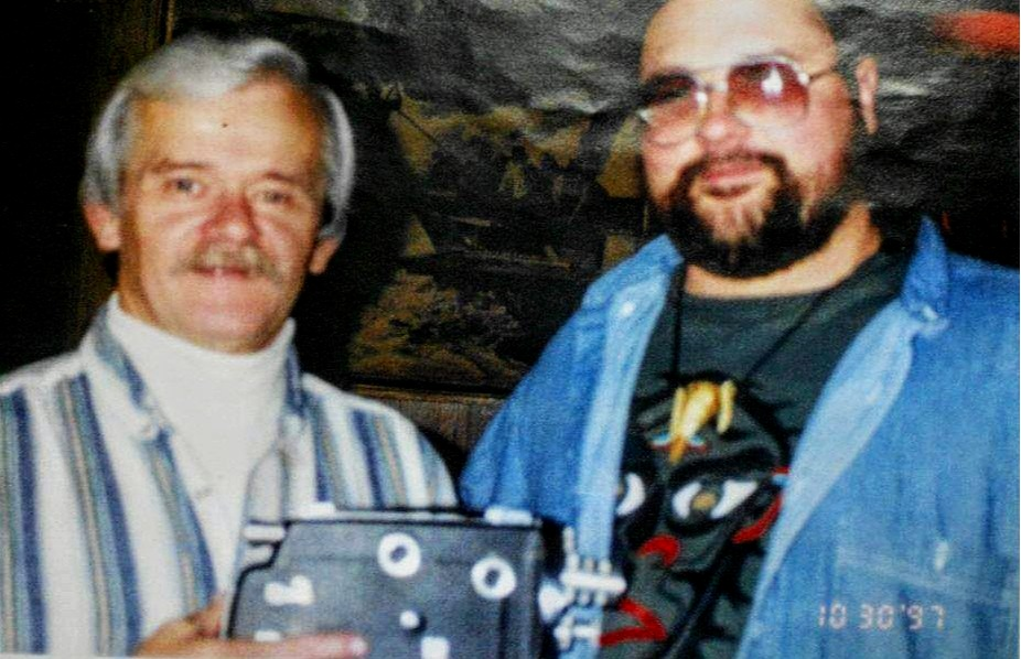 "Listener "" Rob the ToonMan "" with his friend ""Bigfooter"" Larry Lund, holding a Kodak K-100 16mm camera."