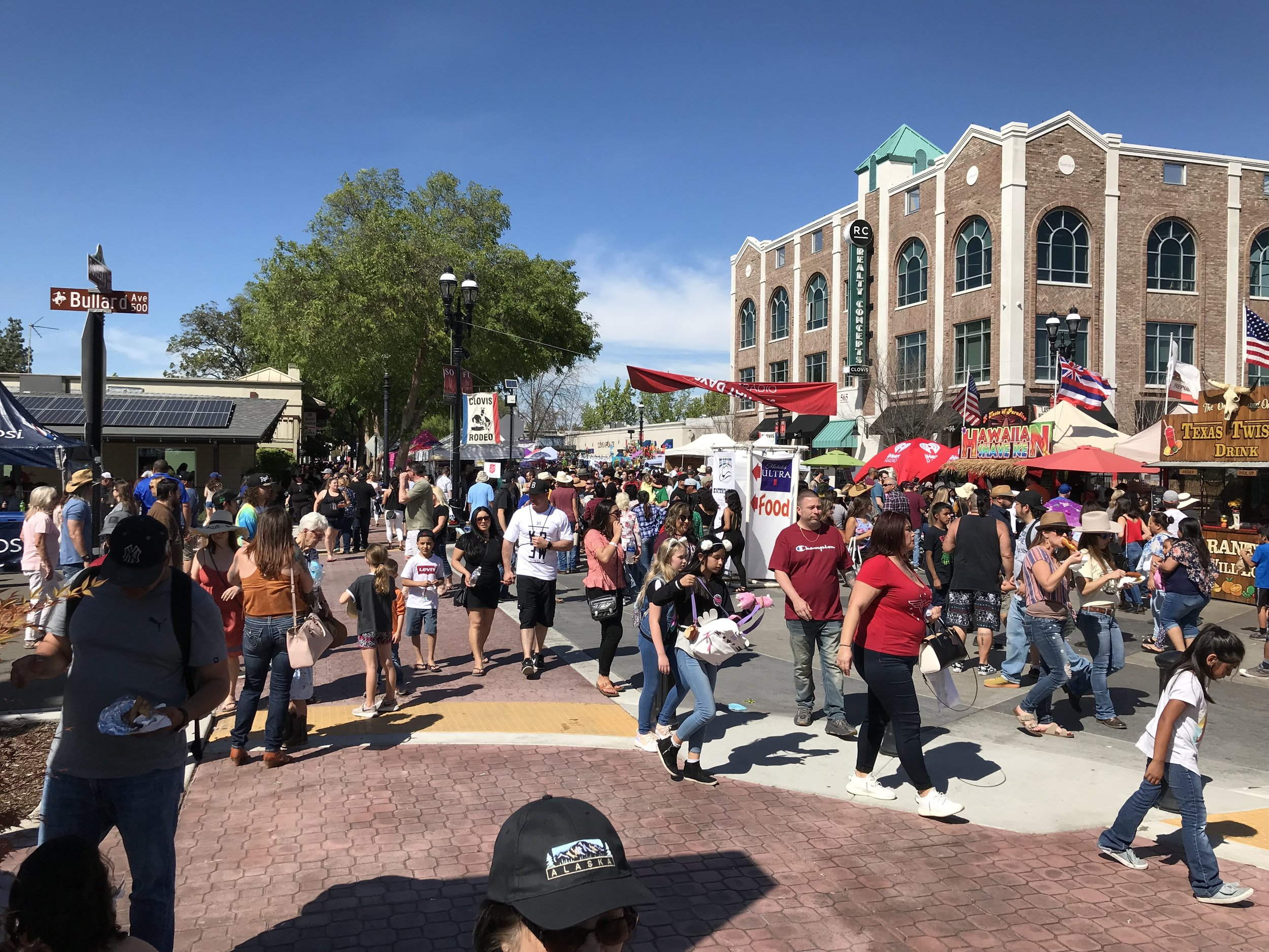"""The central CA town of Clovis and their Rodeo and """"Big Hat Days"""" festival going on during the time of Bob Gimlin's talk."""