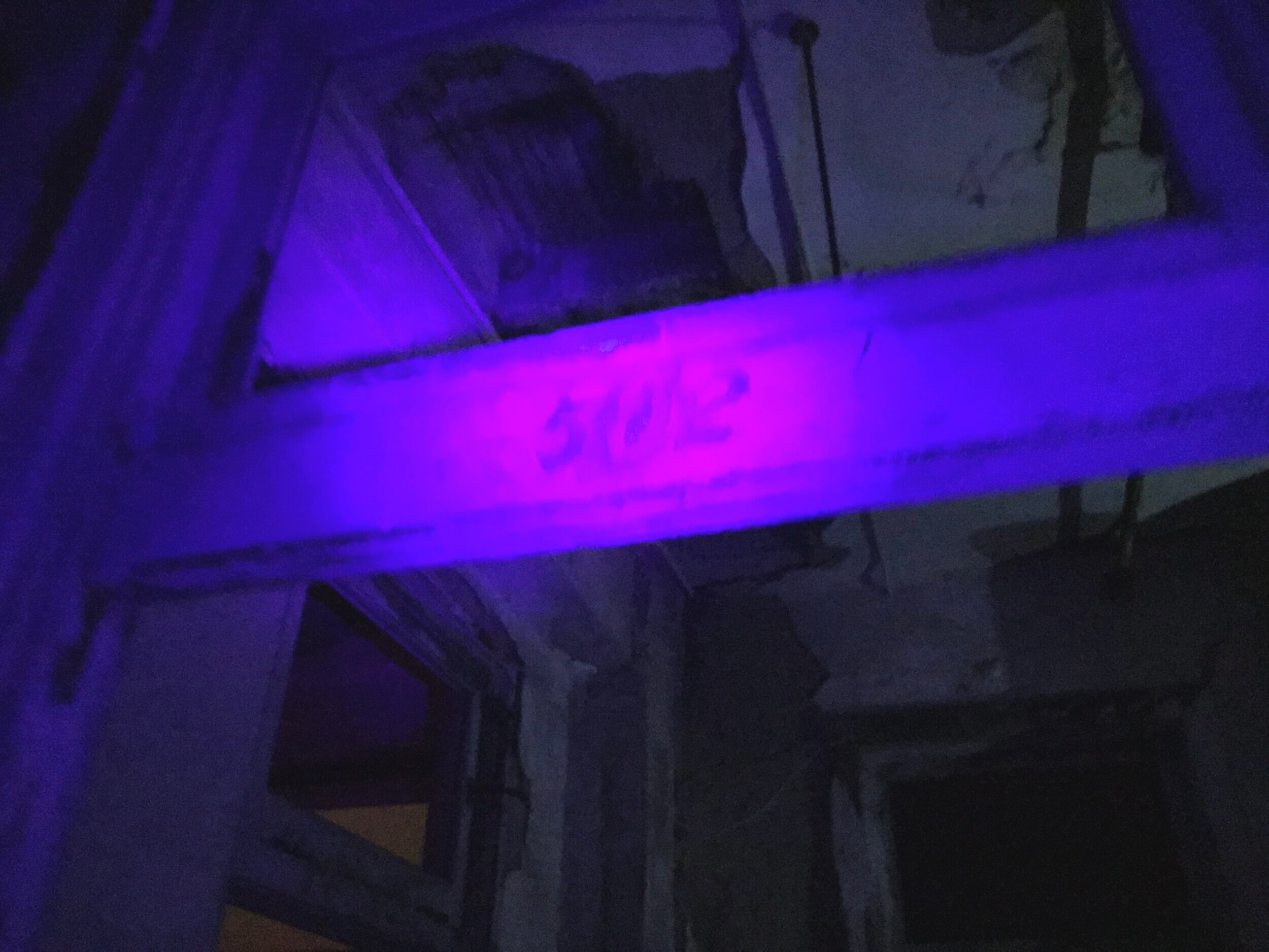Room 502, the location where a nurse supposedly hanged herself either in the room (which is was a bathroom) or just outside the door. One of the many ghost stories at Waverly. The spot where the door numbers were is illuminated with UV light.