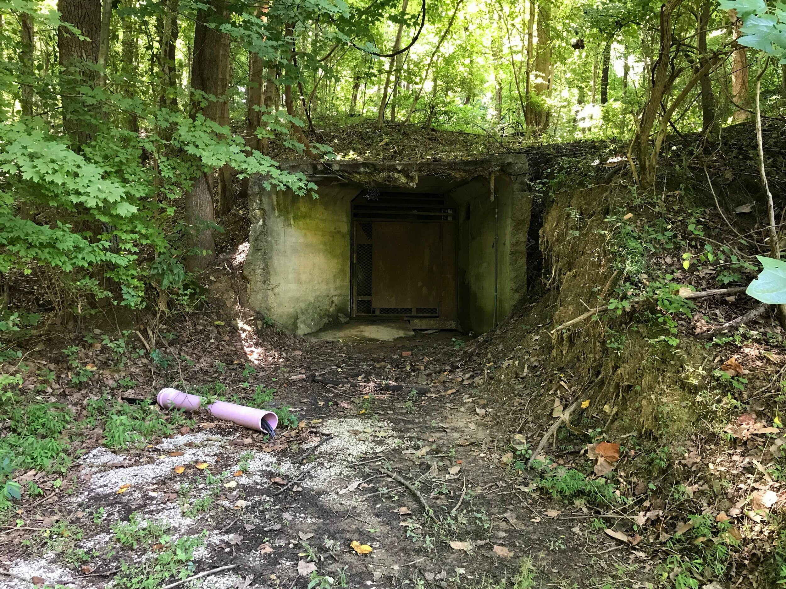 "The ruins of the outside end of the ""Death Tunnel"" at the bottom of the hill, where supplies went up and deceased patients reportedly came down."