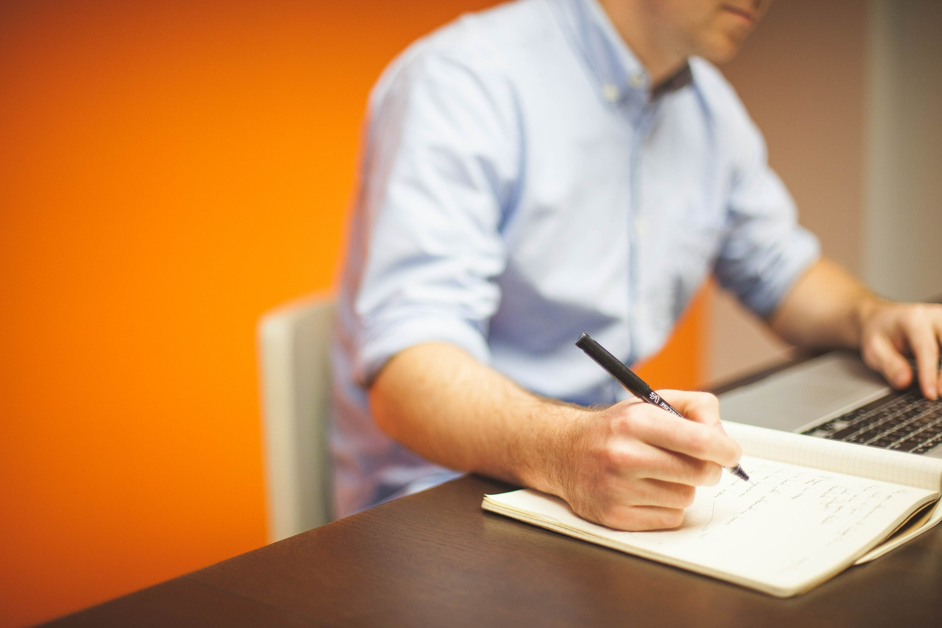 This guy in the stock photo is being agile. See how he's writing AND typing at the same time?!