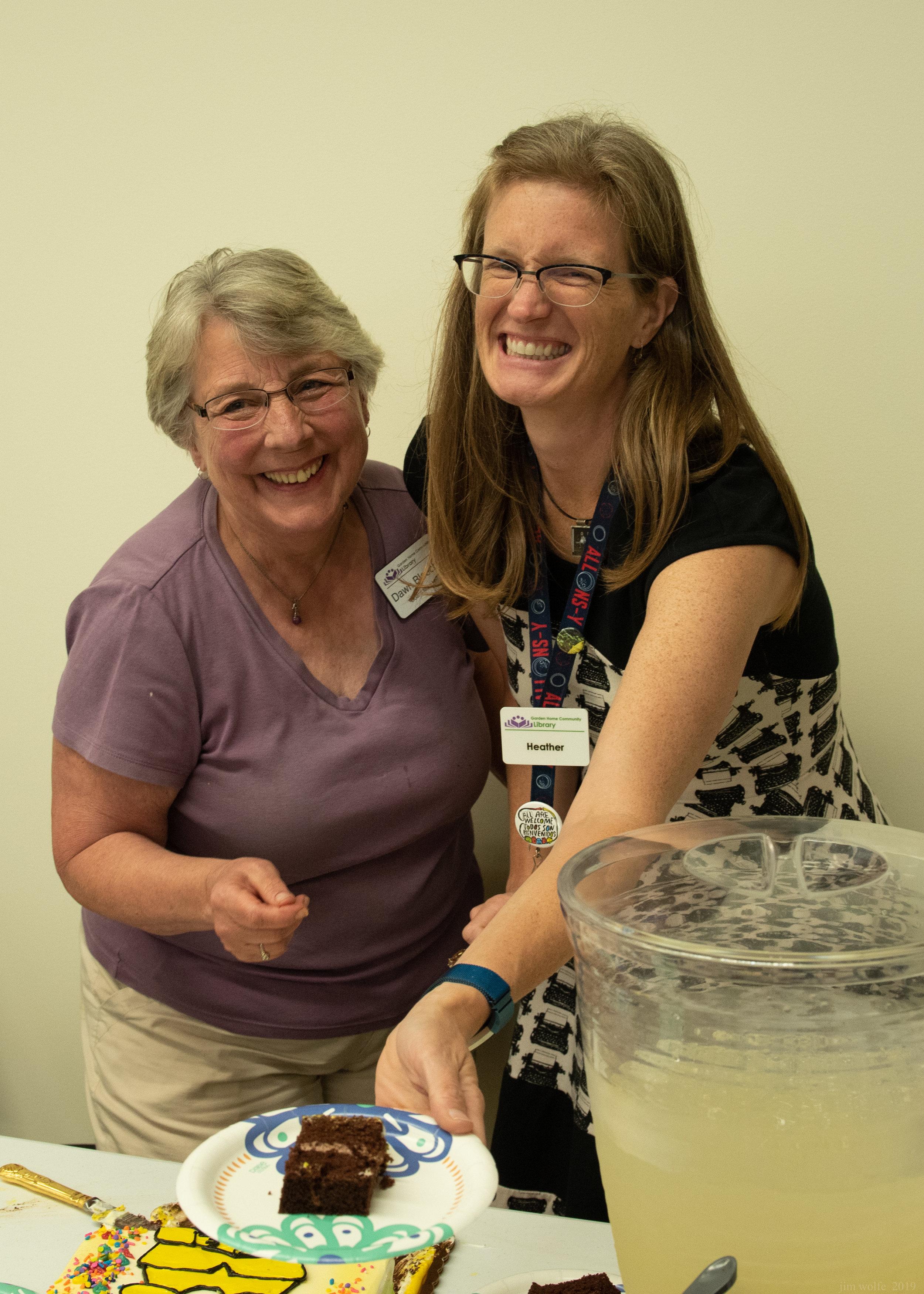 Board Member Dawn Bloechel and Staff Member Heather Waisanen serve cake and lemonade.