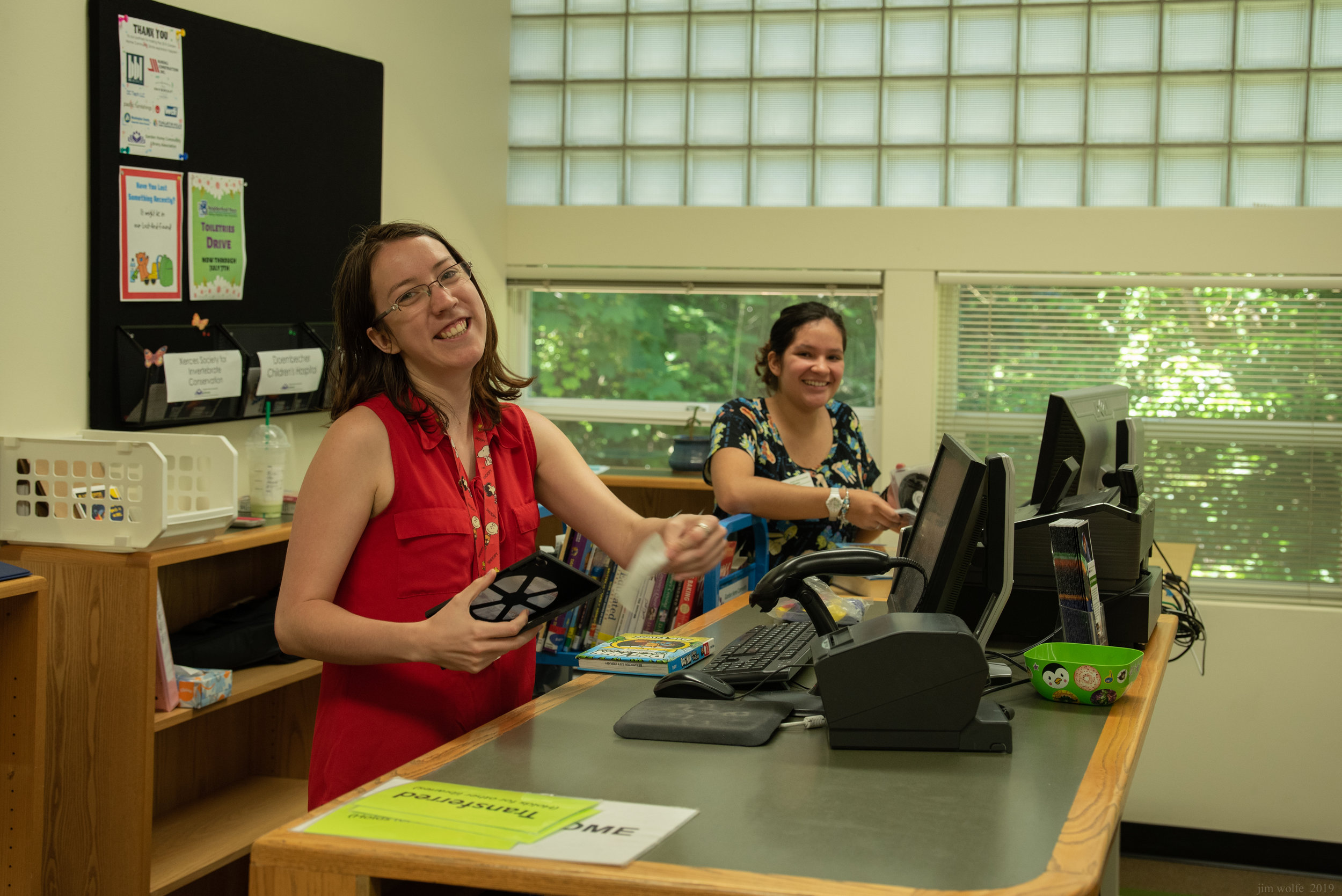 Staff Members Julie Winczewski and Jocelyn Santos at the circulation desk.