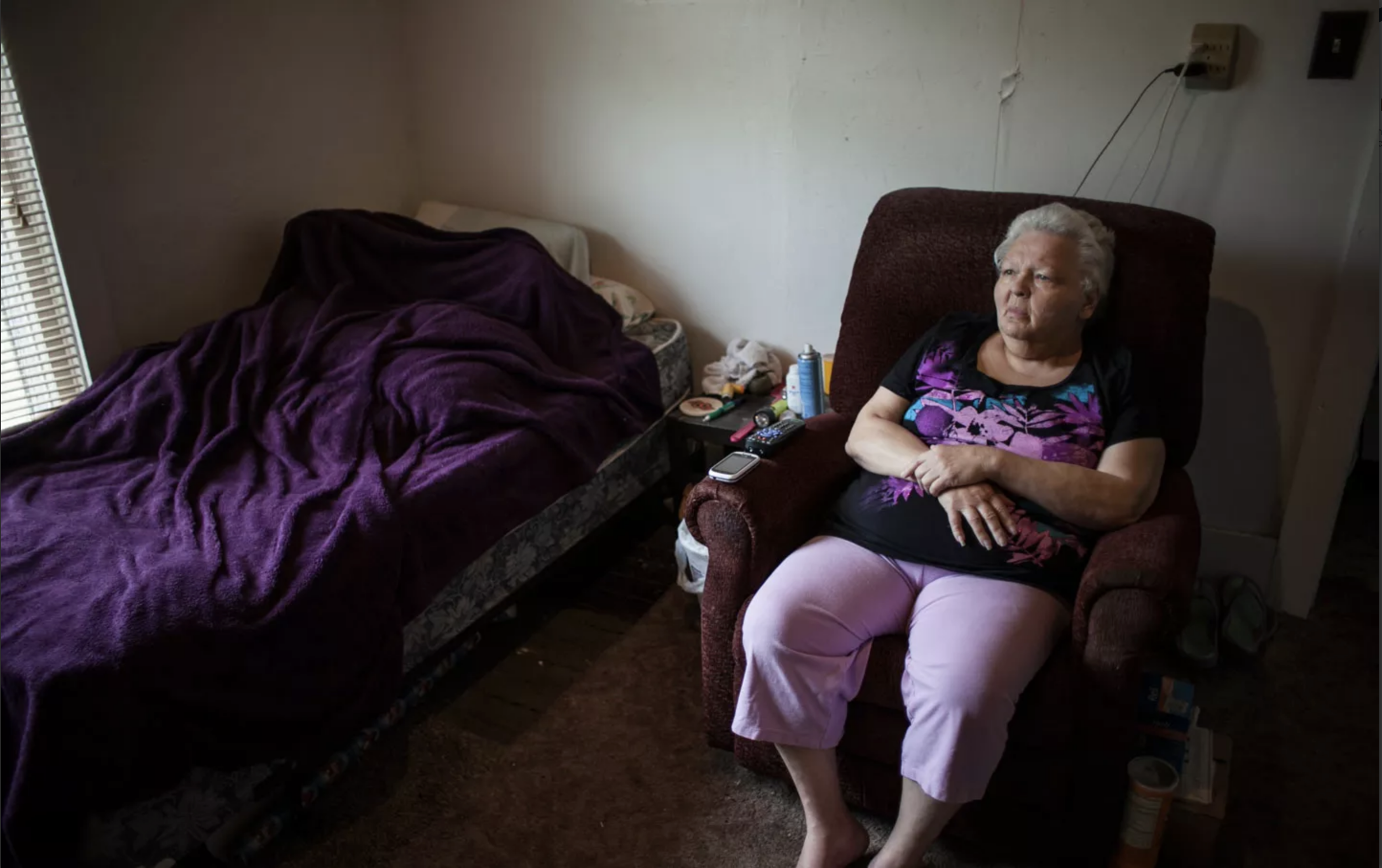 RaDonna Keukelhan sits on her armchair and watches her favorite television show NCIS. (Photographs by Catalin Abagiu)