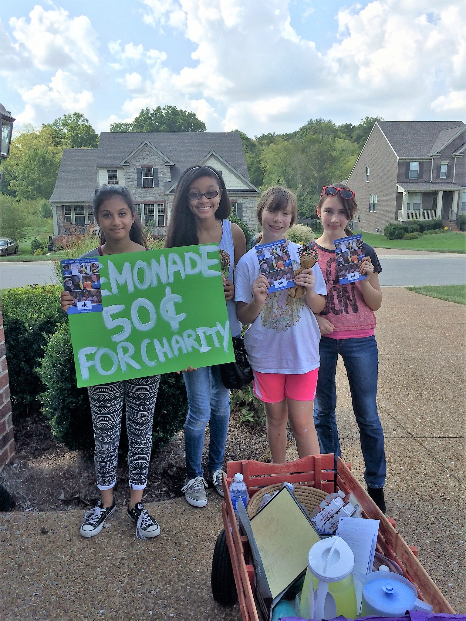 Caroline and her friends hosted a lemonade stand to raise support for RTRA.