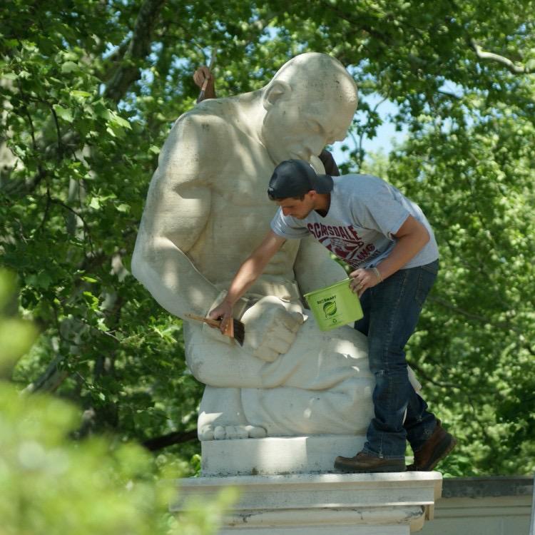 Zach Tatti circa 2016 preforming treatment on an public monument by Hélène Sardeau in Philadelphia.