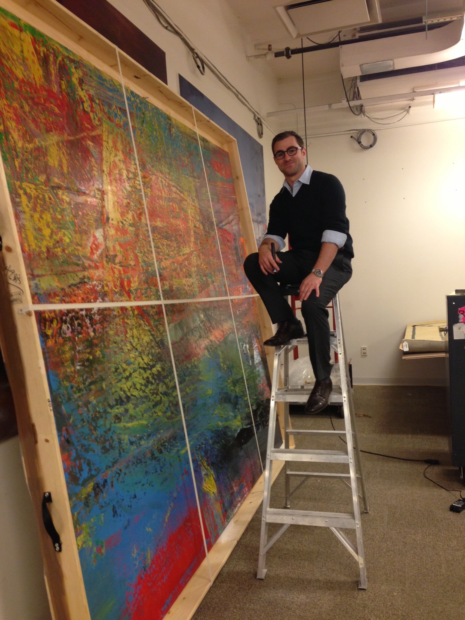 Nick Tatti circa 2014 writing a condition report on a painting by Gerhard Richer.