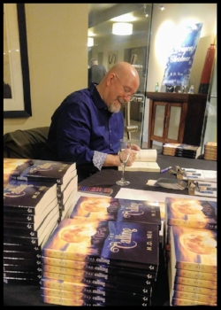 Author M.D. Neu signing books.