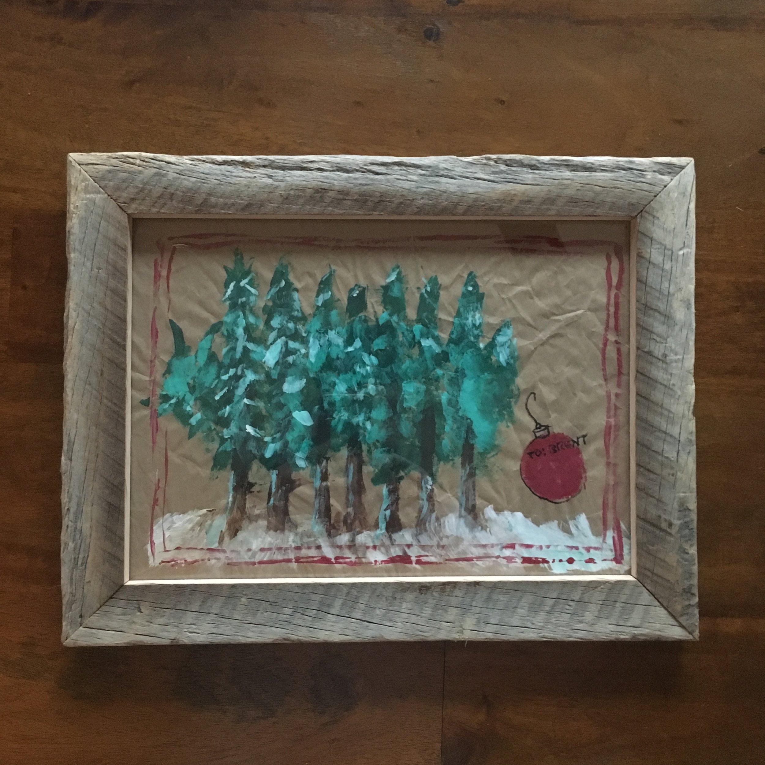 hand painted gift wrap in our shop made reclaimed wood frame