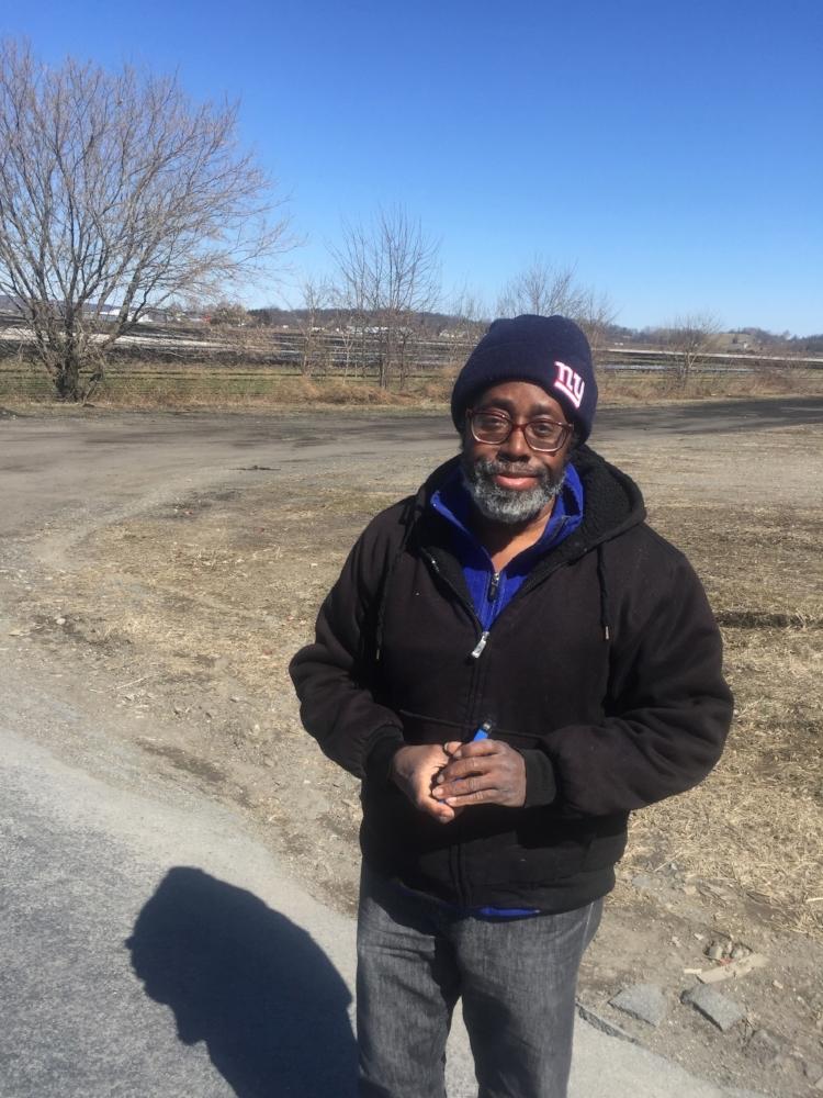 """""""Smokin'"""" Joe Copeland surveys the Black Dirt region of Orange County, NY."""