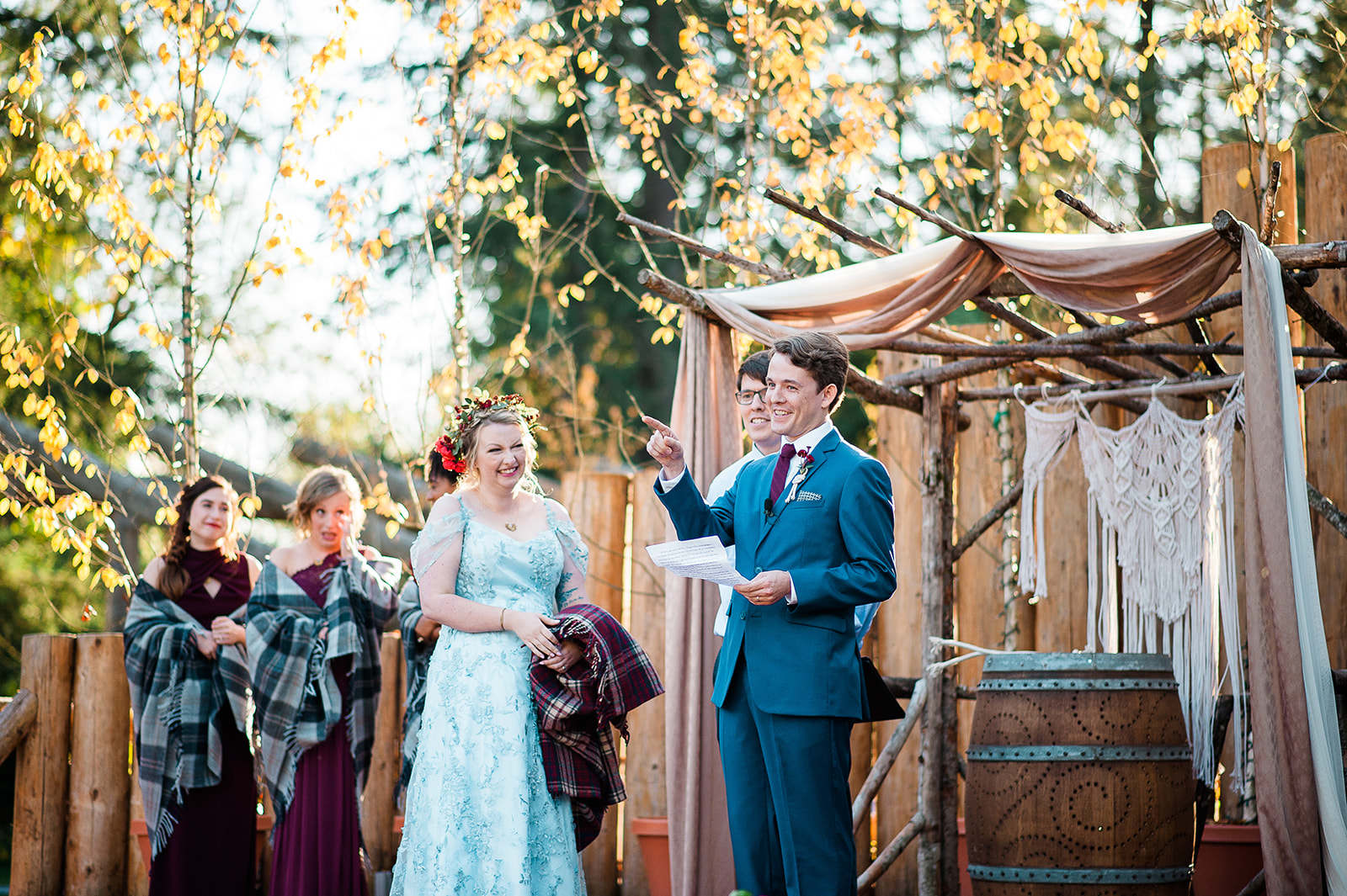 The groom's vows in front of the stage, photo by Photos by Betty  https://bettyelainephotography.com