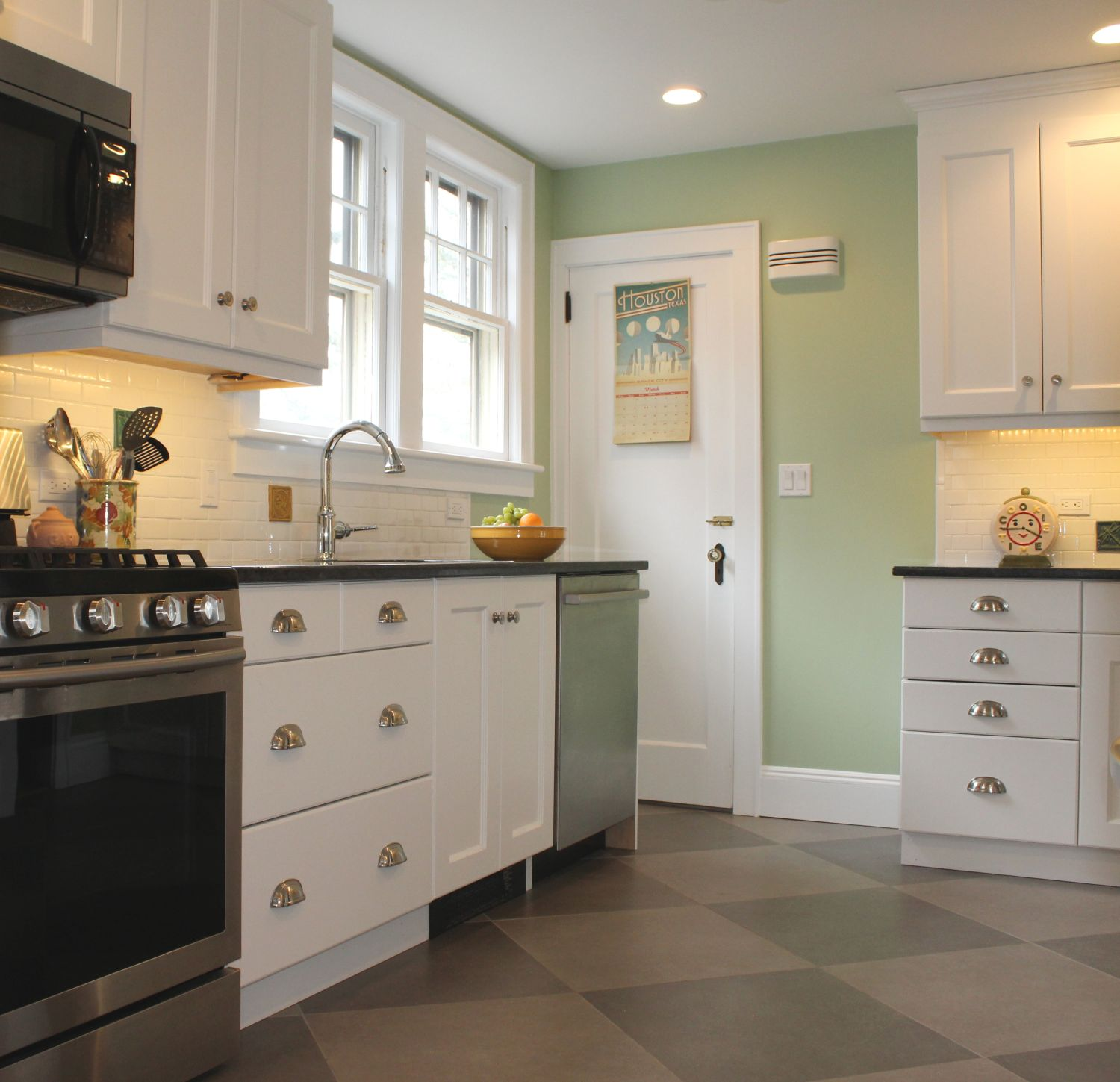 A kitchen with a checkered floor