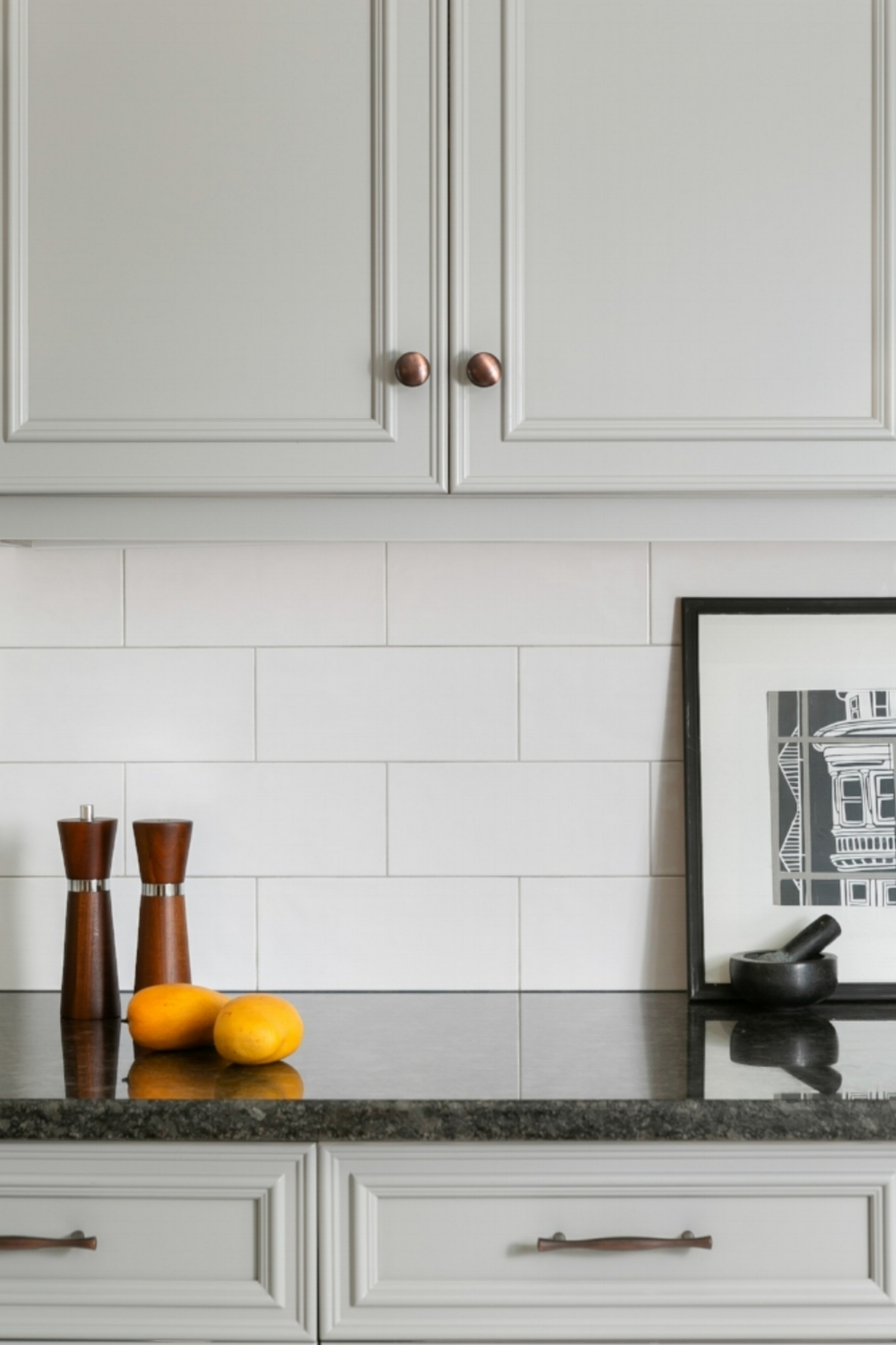 Medium gray cabinets add interest to the kitchen while providing a neutral pallette.