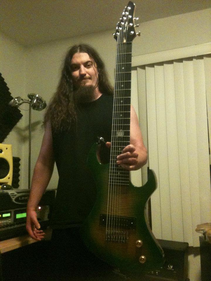 Greg Harrison with the 9-string prototype