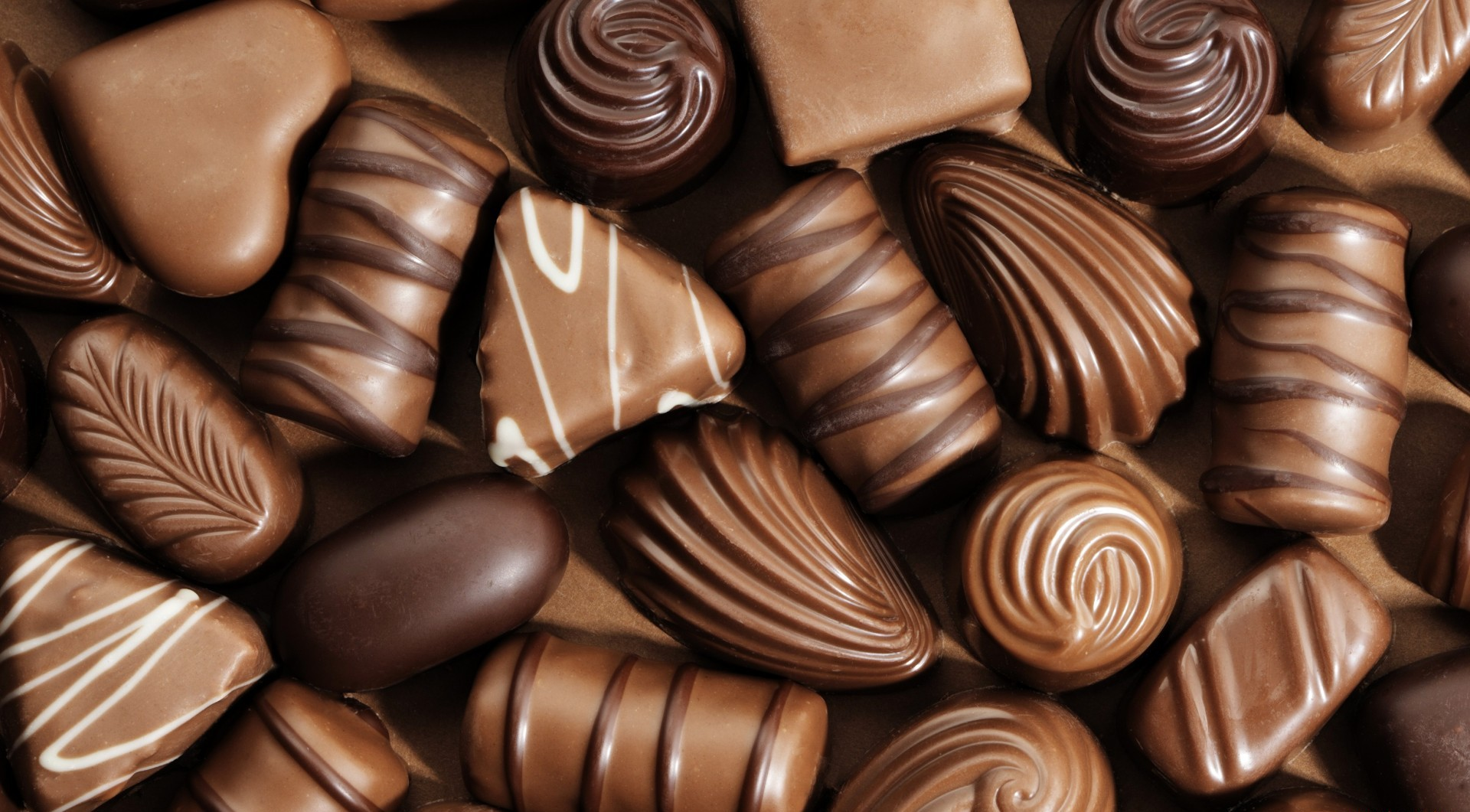 Chocolate   There's a reason those heart-shaped boxes of chocolate are EVERYWHERE around Valentine's Day… First of all, who doesn't like chocolate? But second, chocolate contains certain compounds that aid in the production of  feel-good hormones (namely, serotonin) , which can make you feel good...everywhere! Plus, research shows chocolate can  relieve stress, improve your mood and add a little pep in your step  (read: caffeine) that may help rid the bedroom blahs.   Verdict:  Chocolate's libido boosting properties aren't scientifically proven, but why not munch on a dark chocolate shaped heart to prolong that dance cardio high?